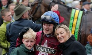 David Mullins (19)  from Goresbridge, who won the Grand National last Saturday aboard Rule the World celebrating  with his mother Helen and brother Charlie