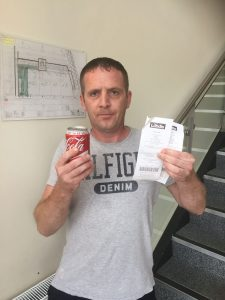Patrick Cahill with his can of coke and receipts from Rath's