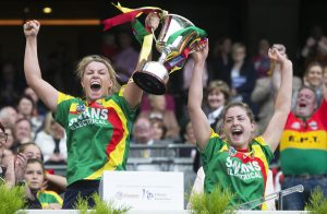 Carlow's joint captains Marian Doyle and Teresa Meaney lift the Kay Mills Cup to the delight of their supporters at Croke Park after their victory over Armagh Photo: Inpho/Tommy Dickson