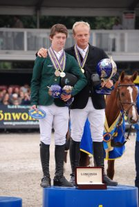 Mikey Pender with his silver and bronze medals alongside winner Willem Greve of the Netherlands